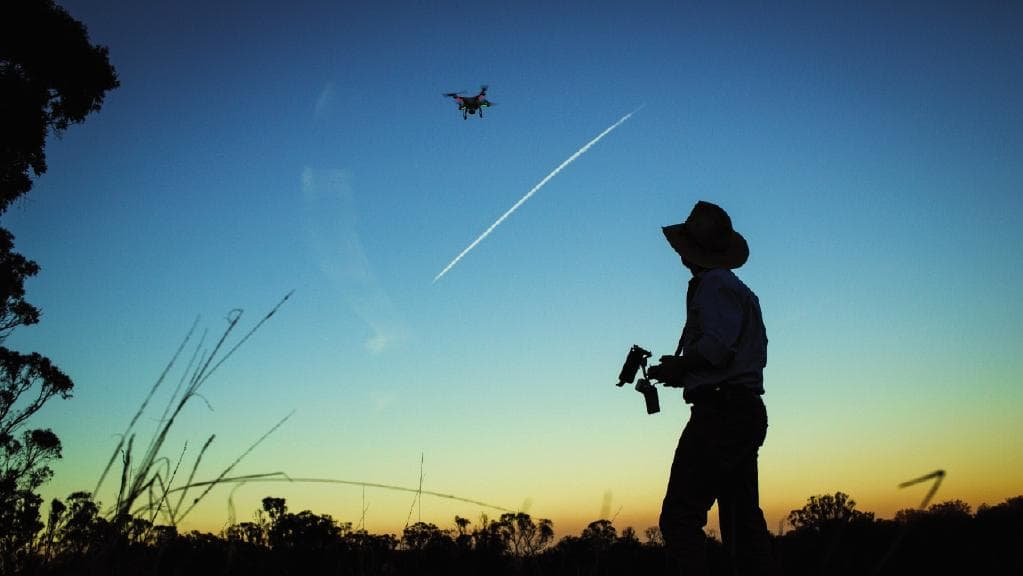 farmer using precision agriculture equipment