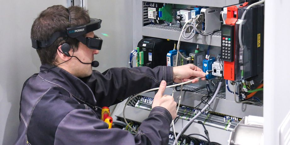 an electrician using digital twin VR glasses